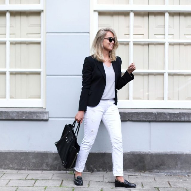black blazer with white slim fit jeans and spiked shoes