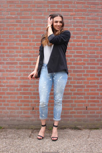black blazer with white T-shirt and light blue jeans with cuffs