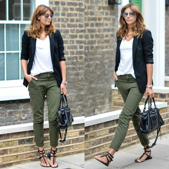black blazer with white top with V-neck and green, narrow-cut trousers