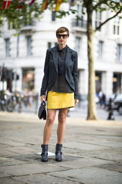 black blazer with yellow leather mini skirt and ankle boots
