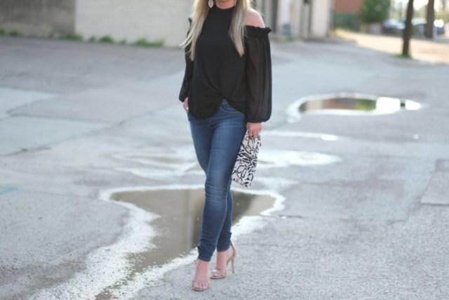black blouse with blue jeans and pink open toe heels