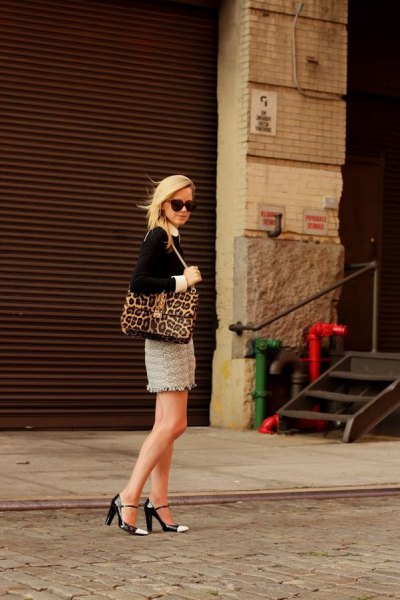 black leopard print blouse with wallet and pink mini skirt