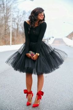 black long-sleeved top with boat neckline and mini tutu dress