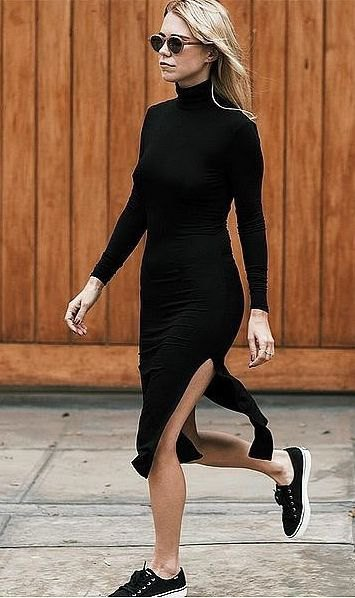 black figure-hugging midi dress with slit