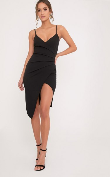 black figure-hugging wrap dress with open toes and ankle straps