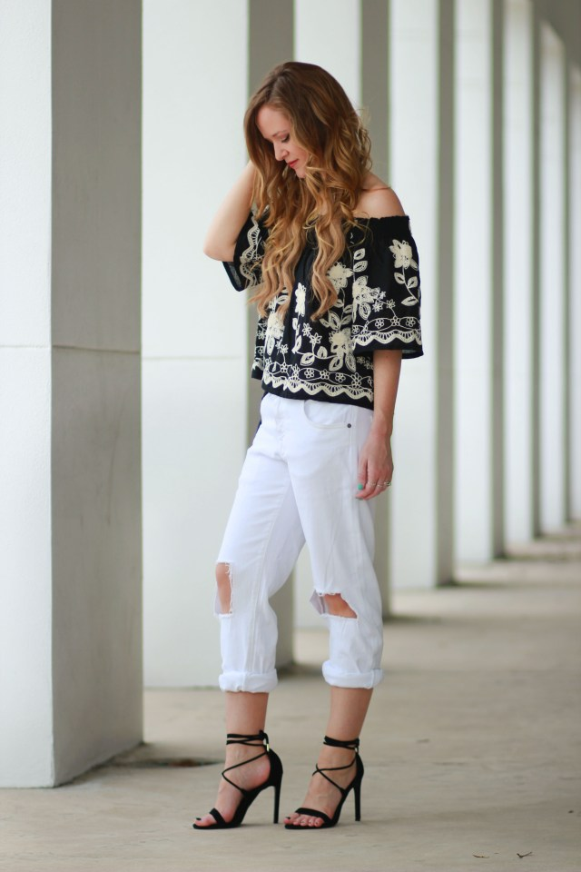 black boho-chic top with boyfriend jeans