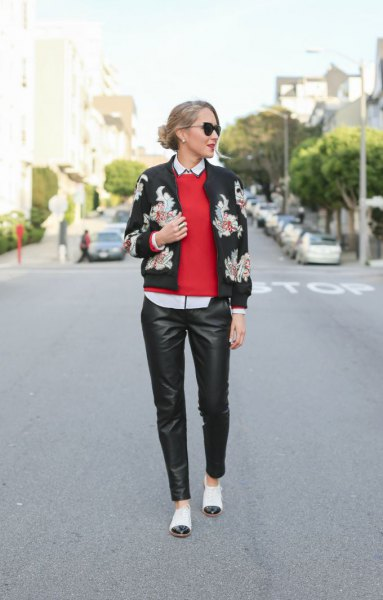black bomber jacket red knit sweater and white cap toe shoes
