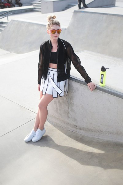 black bomber jacket with crop top and skater skirt