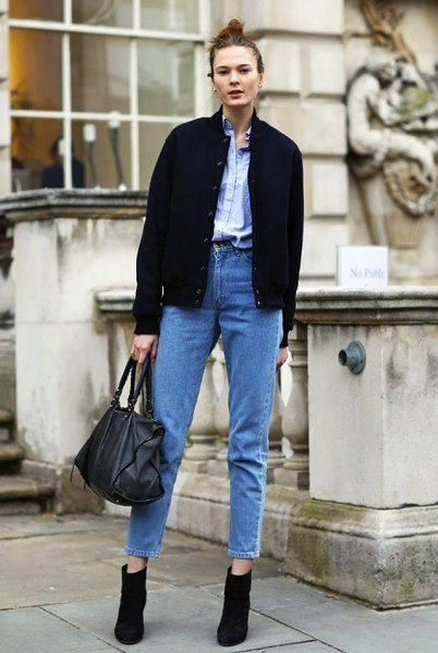 black bomber jacket with light blue shirt and high-waisted vintage mom jeans