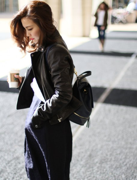 black bomber jacket with dark blue midi dress with backpack wallet