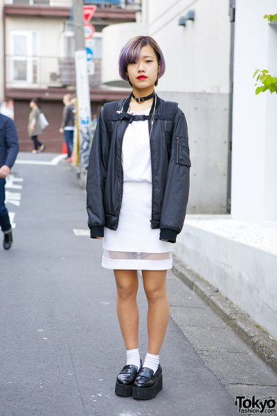 black bomber jacket with white dress with a gathered waist and slippers