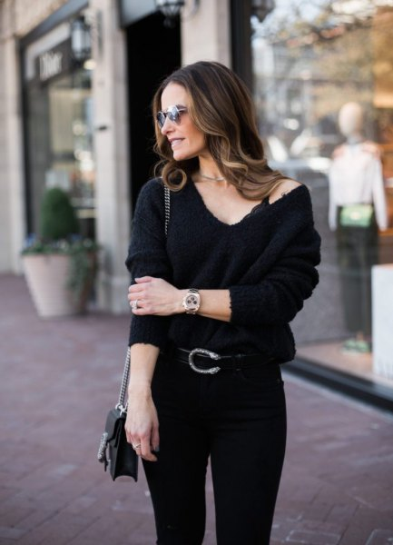 black bralette with a V-neck sweater and skinny jeans