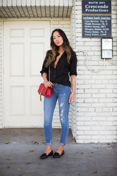 black button-down shirt with light blue skinny jeans with cuffs