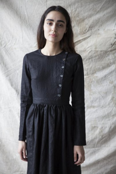 airy dress made of linen with a black button on the front