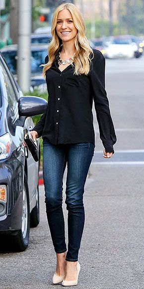 black shirt with buttons, dark blue jeans and white heels