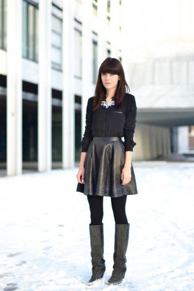 black shirt with buttons and flared leather high skirt