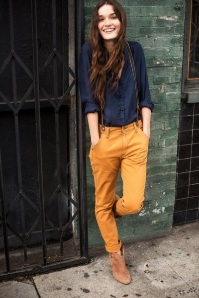 black shirt with buttons and mustard yellow jeans