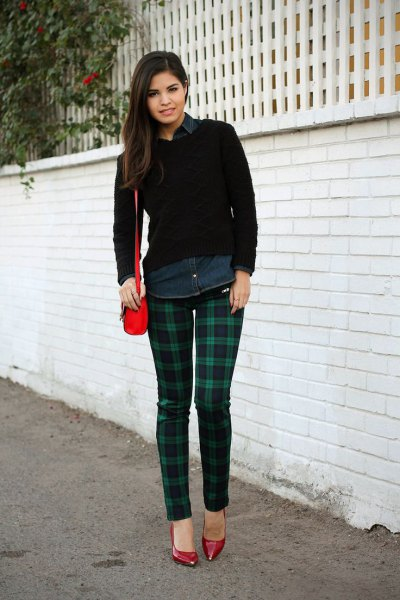 black shirt with buttons and dark blue and green checked pants