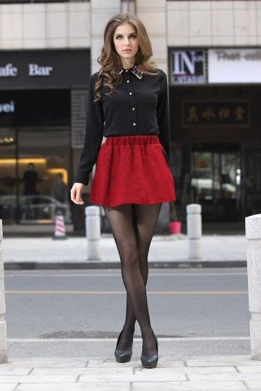 black shirt with buttons and red minirater skirt