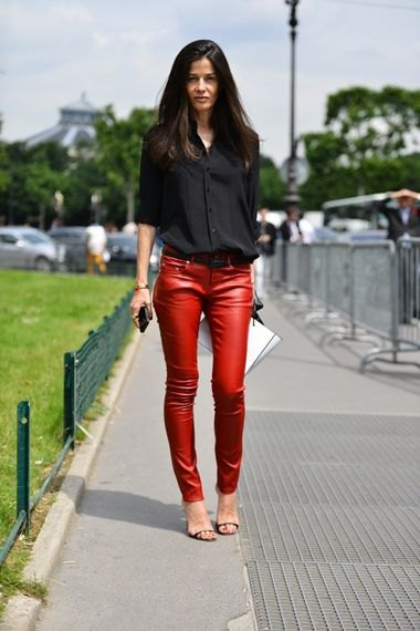 black shirt with buttons and red, narrow leather pants