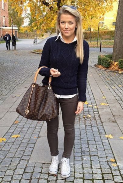 black knitted sweater with white shirt and gray skinny pants