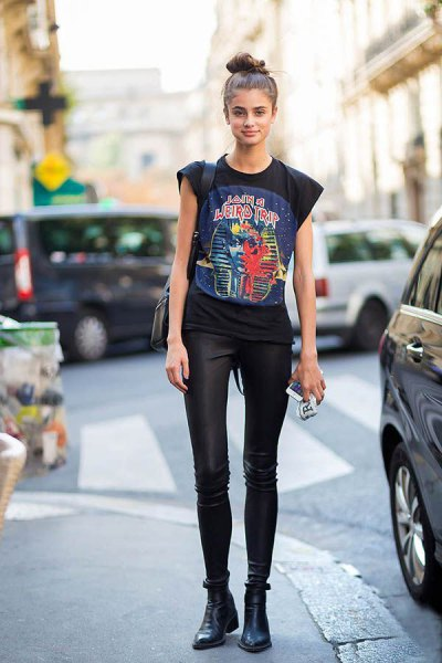 black graphic t-shirt with cap sleeves and slim leather pants