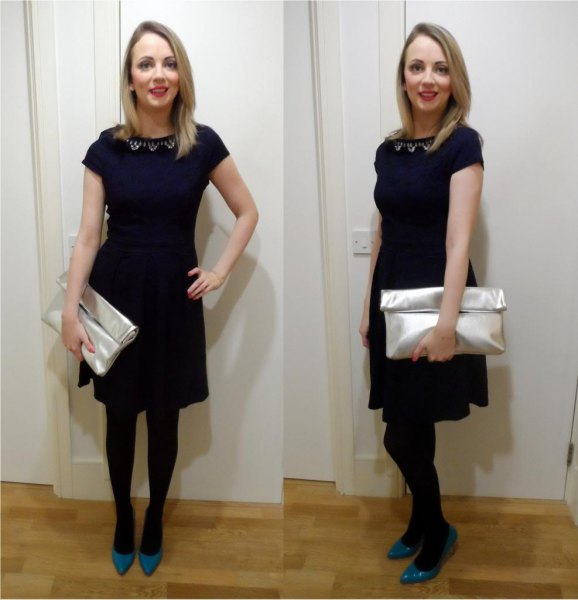 black mini dress with cap sleeves and silver wallet