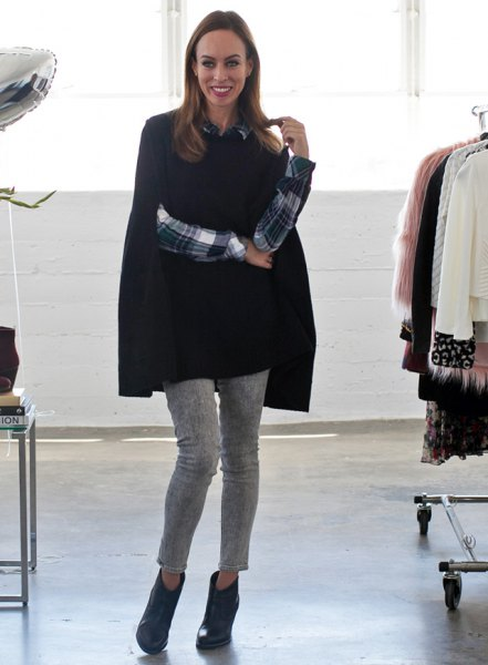 black cape sweater with checked shirt and gray, cropped trousers