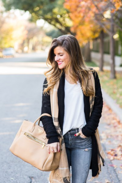 black cardigan sweater with a blushing pink long scarf and gray jeans