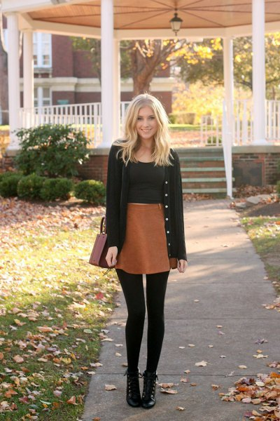 black cardigan with black crop top and brown mini skirt