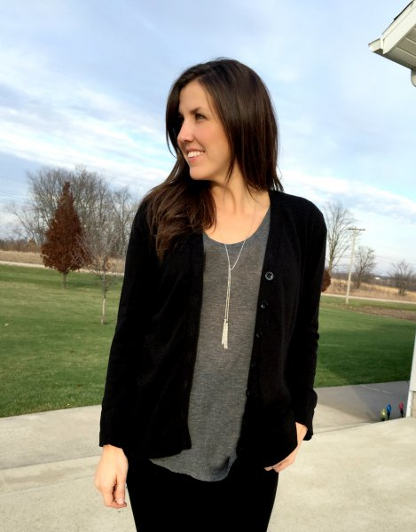 black cardigan with gray scoop neck t-shirt and necklace in boho style