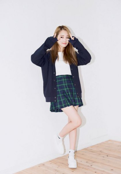 black cardigan with checked mini skirt and white sneakers