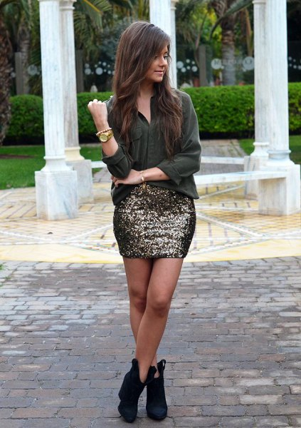 black chiffon blouse with buttons and dark sequined mini skirt