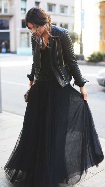 black maxi dress made of pleated chiffon with leather jacket
