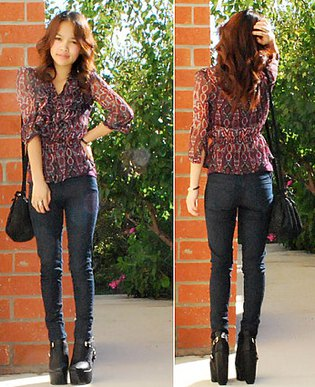 black, semi-transparent chiffon blouse with dark drainpipe jeans and leather ankle boots with high heels