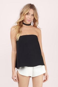 black choker with strapless blouse and white, flowing mini-shorts