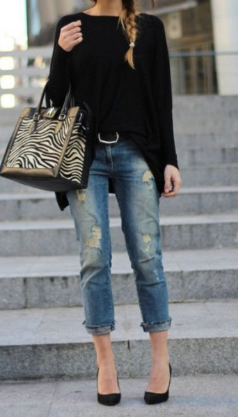 black, chunky sweater with cuffed jeans and ballerinas