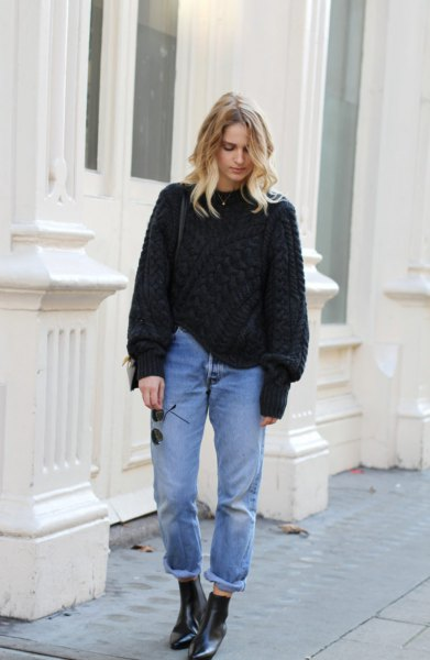 black, chunky sweater with tied mom jeans