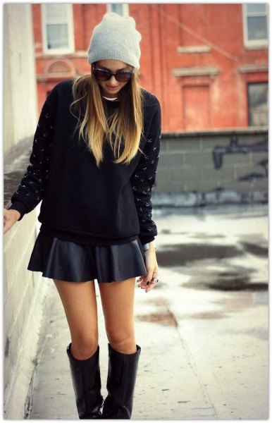 black, chunky sweater with minirater skirt and knee-high boots