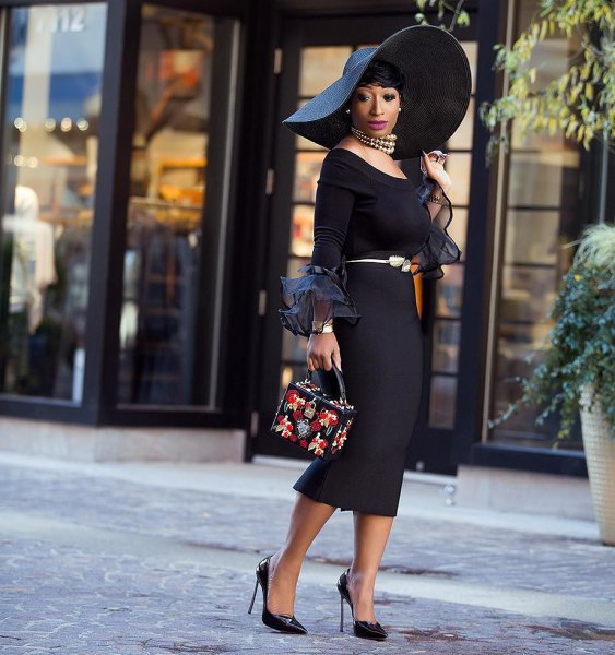 black church suit with large floppy hat