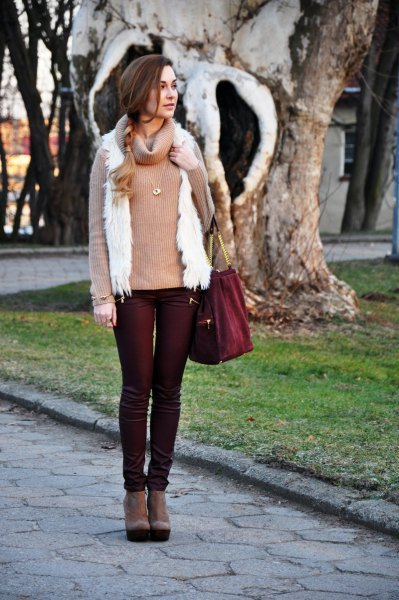 black coated jeans with a red turtleneck and white vest
