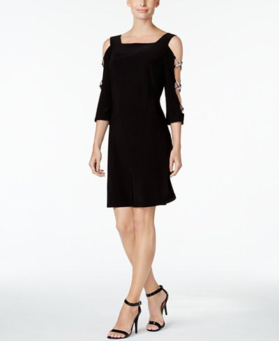 black mini dress with cold shoulder and open toe heels