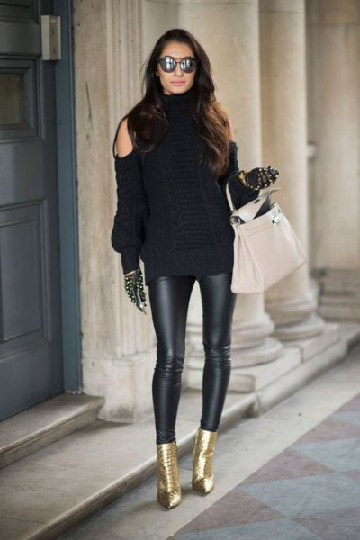black cold shoulder sweater with leather gaiters and metallic ankle boots