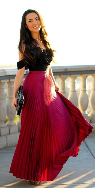 black cold shoulder top with red pleated skirt