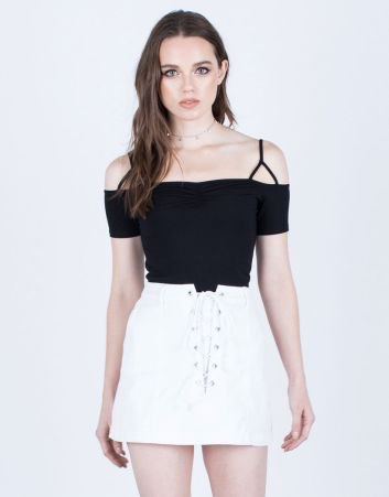 black cold shoulder top with white denim skirt with laces