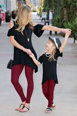 black tunic top with cold shoulder and burgundy leggings