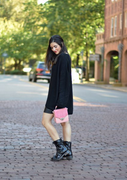 black combat boots black knitted sweater leather skirt