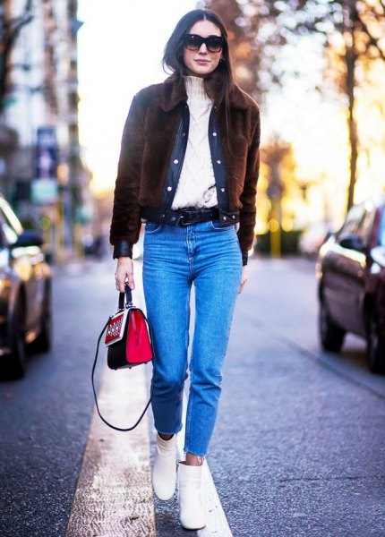 black corduroy jacket with cable knit sweater and blue jeans