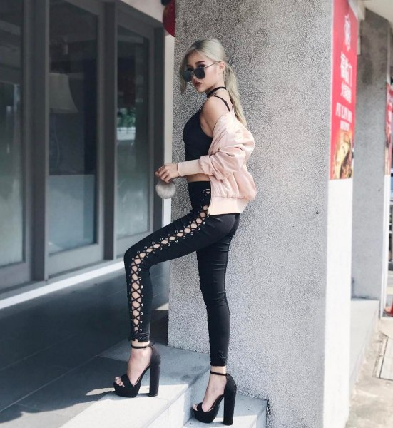 black crop top with lace-up gaiters made of leather and high heels with open toes