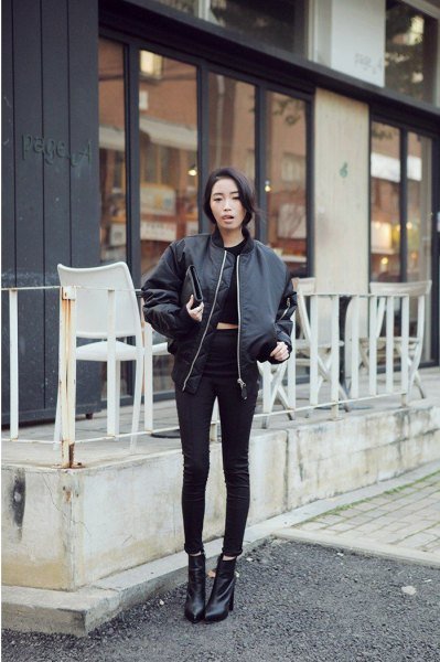 black crop top with skinny jeans and leather flight jacket